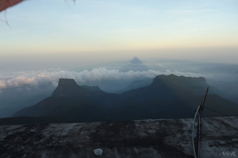 Our lucky day - the enigmatic shadow cast by Adam's Peak is a perfect triangle for only a short time in the morning
