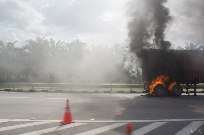 The Malaysian highways were fraught with danger. We shockingly saw more accidents in a week in Malaysia, including this truck with burning tires, than we did in two months in India