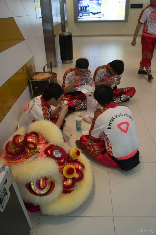 The Chinese New Year dance team on a well deserved break, there are 8 floors of stores in the enormous Digital Mall
