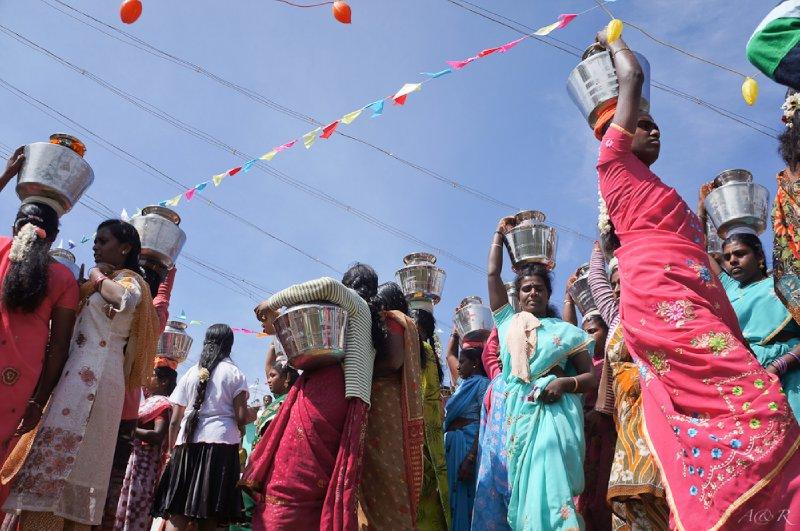 Hindu women carrying buckets of water up to a well as part of a festival in a small village we stumbled upon during our trek.