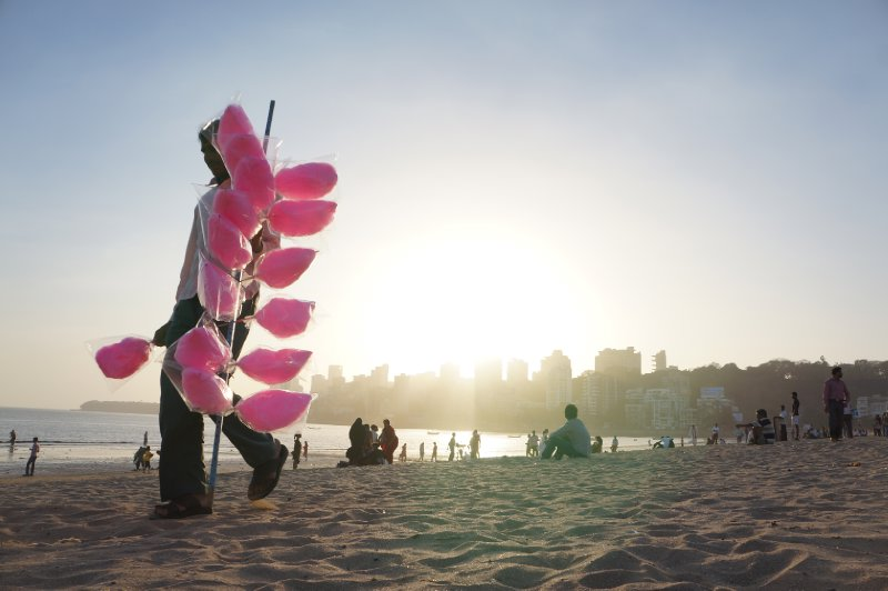 A man selling fairy floss at Mumbai's Chowpatti Beach