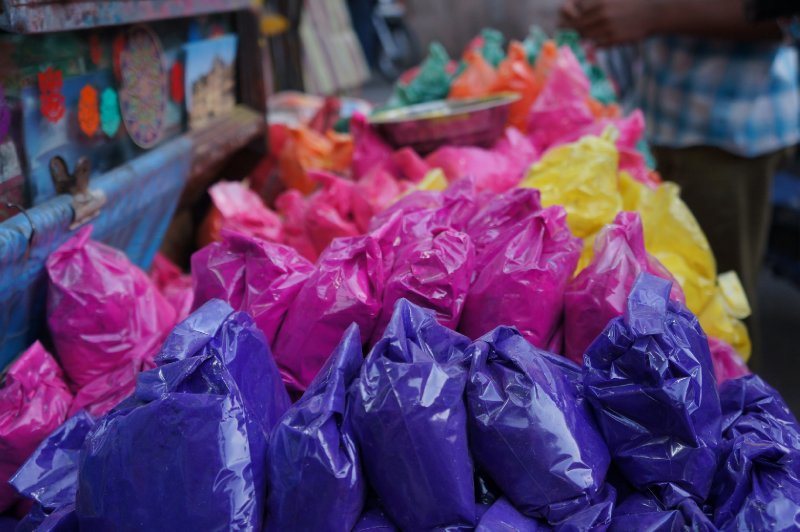 Coloured powders about to cover the thousands of people attending Holi - The Festival of Colours in Udaipur