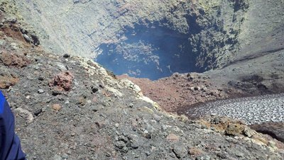 Picking inside the crater of an active volcano