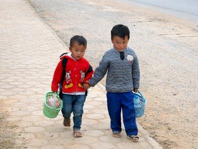 Little boys on main road in Phonsavon
