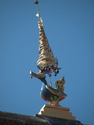 Burmese influenced bird in middle of temple roof peak