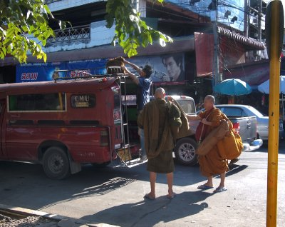 Buddhist monks disembarking from song-taew in Chiang Mai
