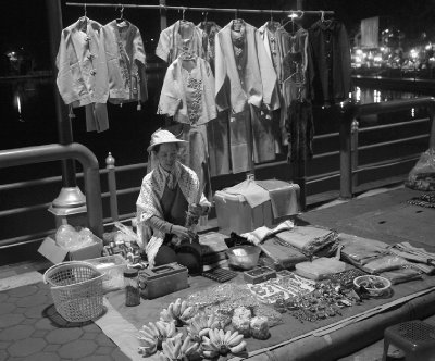 A woman selling her wares in the night market