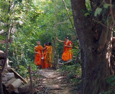 Monks on other side of Nam Kahn river
