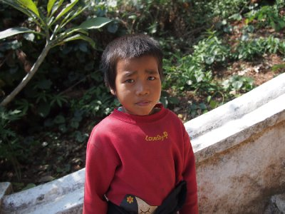 Sad, ethnic child asking for alms