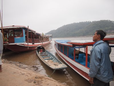 Our boat and driver (right) to the Pak Ou caves