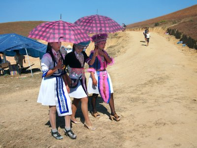 Three young women on way into festival