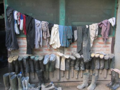 Typical camp scene, gumboots and dirty wet clothes
