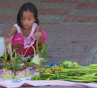 9. Local girl arranges her baskets