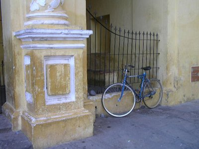 GUATEMALA - Antigua - yellow church - bicycle