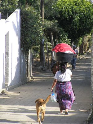 GUATEMALA - Lago Atitlan - San Pedro la Laguna - woman and dog