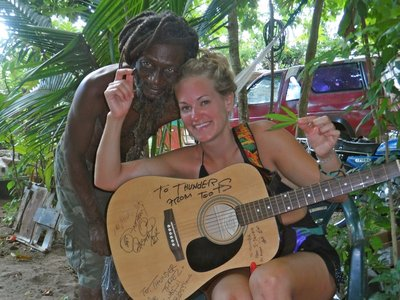 Playing the guitar with rasta Joe