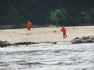 laos monks by water