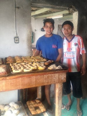 Bakers posing at the bakery with their product