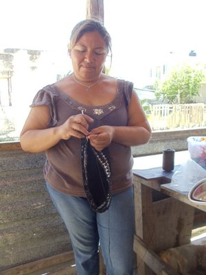Delores making one of the crocheted bags She will custom make them in any colour and size.