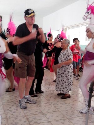 Dara dancing with one of the seniors