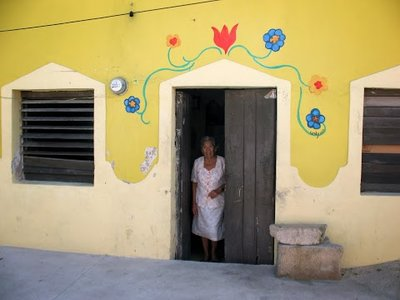 cute old lady and her house in Celestun