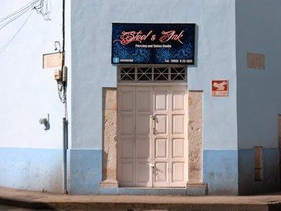 tat shop and street sign