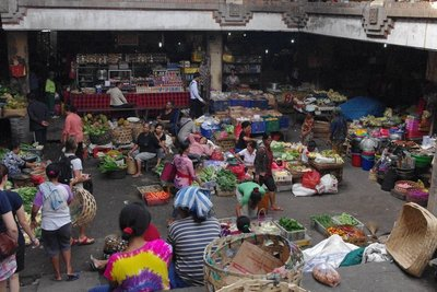 Morning market in central Ubud. Women chilling on their vegetables.