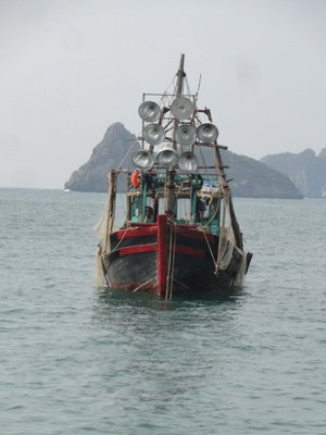 Fishing boat with lights for attracting fish