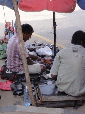 Shoe repairman on the corner
