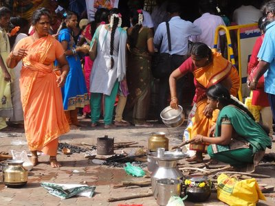 Women preparing rice for devotees attending a Shiva festival