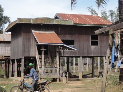 A village house, which looks just like the Cambodian houses along the road.