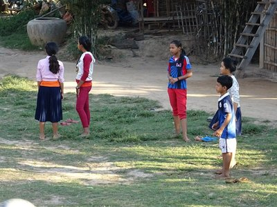 Children playing football (soccer) in front of our cabine