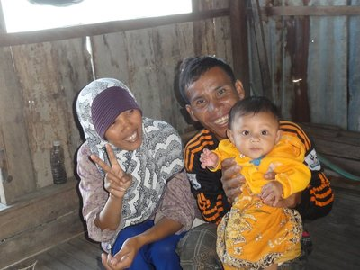 Mr. Ya with his wife and baby