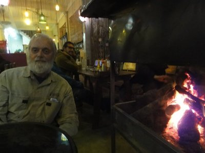 Don sitting by the fire our last night in Son Trach