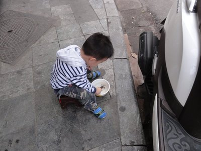 Little boy with pet crabs