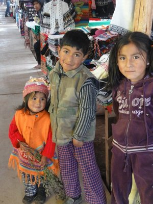 Kids in a market, very happy to have their picture taken