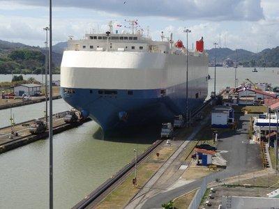 Large ship being towed thru the lock