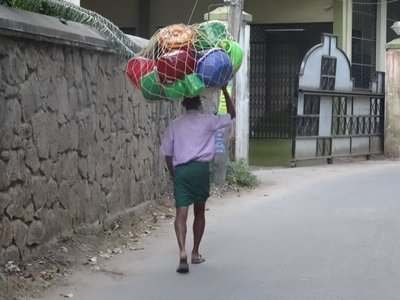 Everyone carries large bundles on their heads, often with no hands!