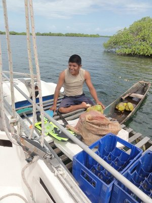 Luis with coconuts and dugout