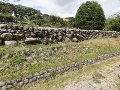 Dry stone wall with stone lined drainage ditch