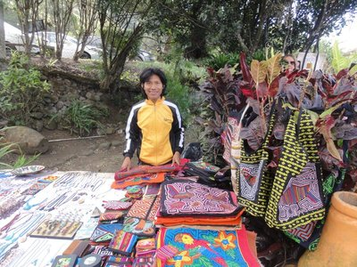 Young man selling molas for his village