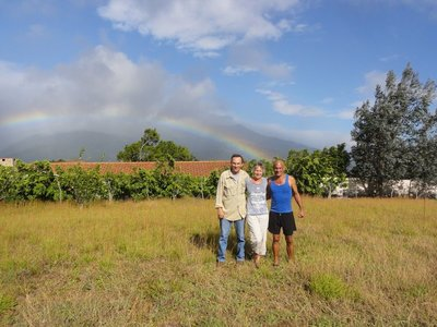 Larry, Cathy, and Ivan with the rainbow