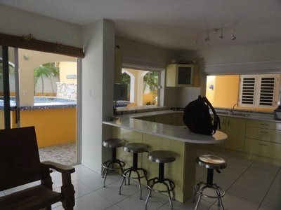 Kitchen with pool outside window