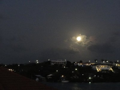 Full moon rising across the bay