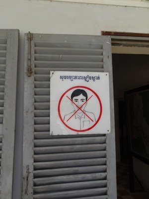 A 'No Smiling/Laughing' sign at the Genocide Museum. As if you need reminding.