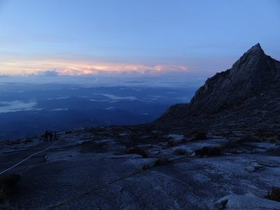 Dawn breaks on the sheer slopes of Mt. Kinabalu
