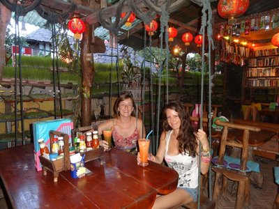 In the Good Life cafe in Pai, with Carole, on swings!