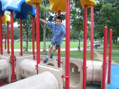 Tom on outdoor equipment in park KL
