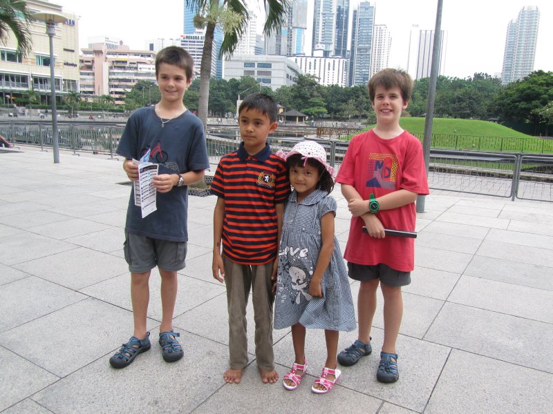 Tom and Ethan with two children they met in KL