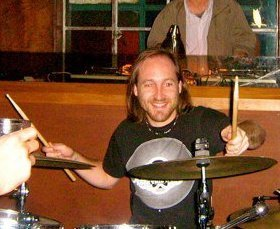 Tom on the drums